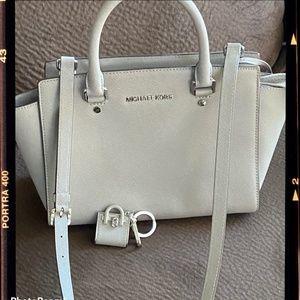 Mickael Kors gray handbag with similar keychain